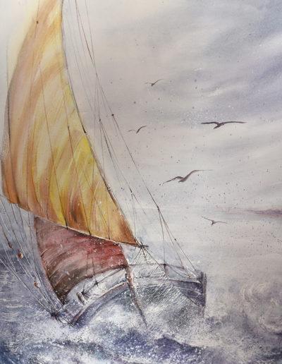Barca a vela nel mare mosso
