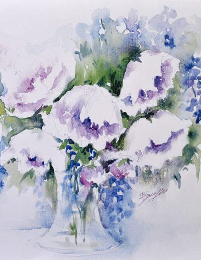 Vaso con fiori blu